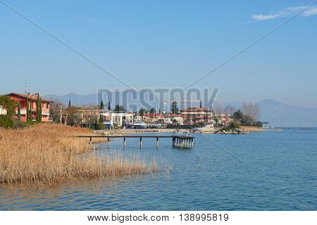 landscape of coastline of Sirmione in a winter. Sirmione is a famous vacation place in the northern Italy.