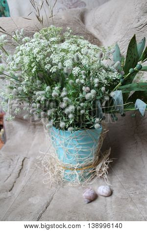 beautiful bouquet of flowers in light gray colors
