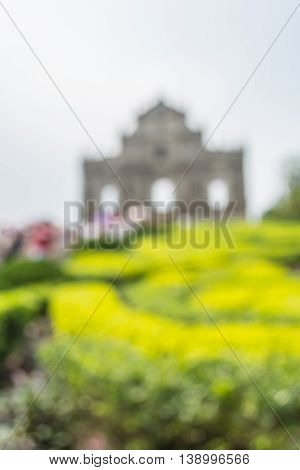 The Ruins of St. Paul's a famoust tourist attraction in Macau in blurred version with green bush and blue sky.