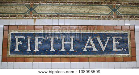 NEW YORK - JUNE 14, 2016: Mosaic sign at The Fifth Avenue Subway Station in Manhattan