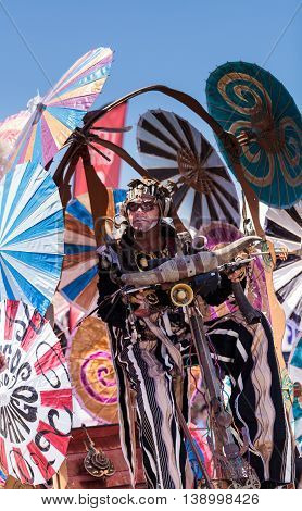 Costa Mesa, CA - July 16, 2016: Theatrical circus performer Derrick Gilday, part Mango and Dango, performs with Dragon Knights steampunk stilt walkers at the Orange County Fair in Costa Mesa, CA on July 16, 2016. Editorial use only.