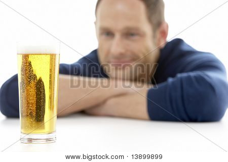 Man Looking At Glass Of Beer