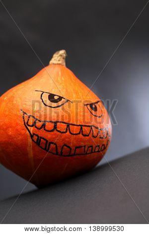 Halloween symbol. Pumpkin head on dark background with free space