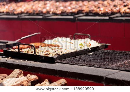 Sausage on a barbecue to cook at a fair ground.