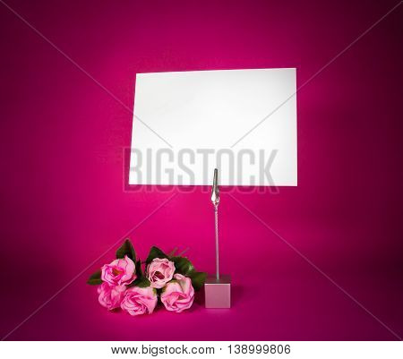 Note holder with the male butterfly with rose and empty card on rose background