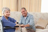 stock photo of old couple  - Mature couple looking at the camera - JPG