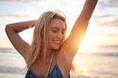 Smiling Young Caucasian Woman At The Beach poster