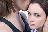 stock photo of forgiven  - Man comforting crying distressed young woman in tears - JPG