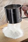 picture of flour sifter  - Sieving the flour using the steel sifter - JPG
