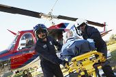 picture of medevac  - Paramedics unloading patient from Medevac - JPG