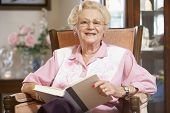 picture of elderly woman  - Senior woman reading book - JPG