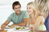 foto of young adult  - Friends Having Lunch Together At Home - JPG