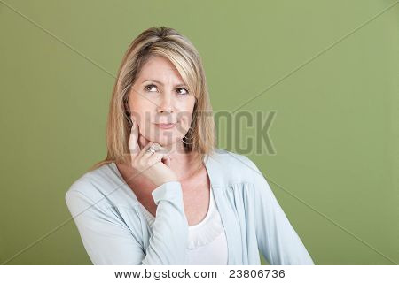 Woman With Finger On Chin