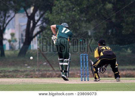 PUCHONG, MALAYSIA - SEPT 24: Malaysia's Mohd Safiq watches Guernsey's Ben Ferbrache (17) hits at the Pepsi ICC World Cricket League Div 6 finals in Kinrara Oval on Sept 24, 2011 in Puchong, Malaysia.