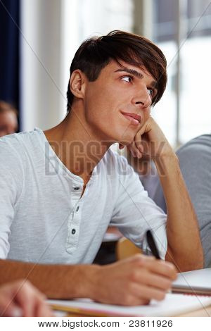 Pensive Student Listening To Lecture