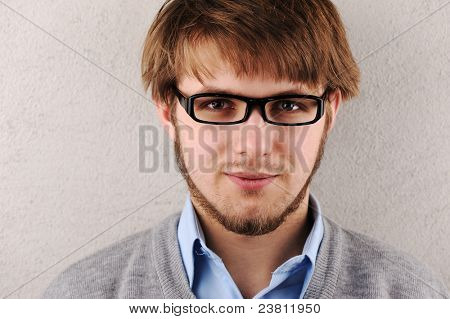 Young man portrait with glasses
