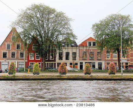 Colorful Dutch houses along the canal in Haarlem, Holland.