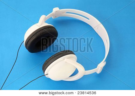 White Stereo Headset with black stars and wire on blue background