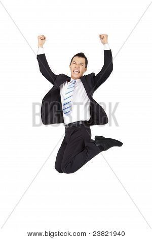 happy businessman jumping and isolated on white background