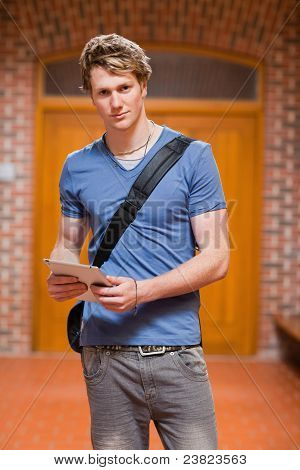 Portrait Of A Handsome Student With A Tablet Computer