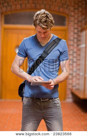 Portrait Of A Handsome Student Using A Tablet Computer