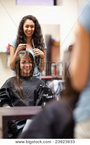 Portrait Of A Woman Making A Haircut