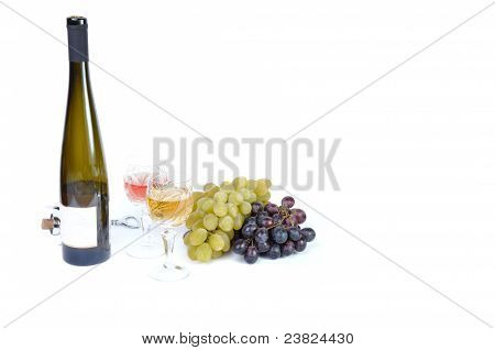 Bottle of wine with aperitive glasses of wine and grapes