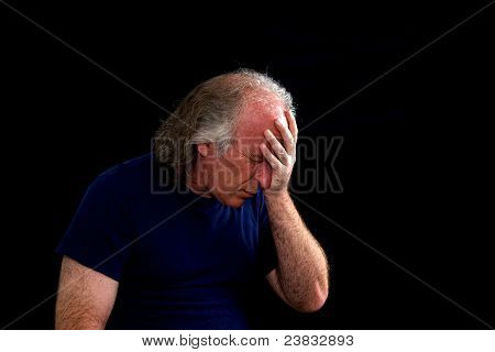 Upset Man Holding Head