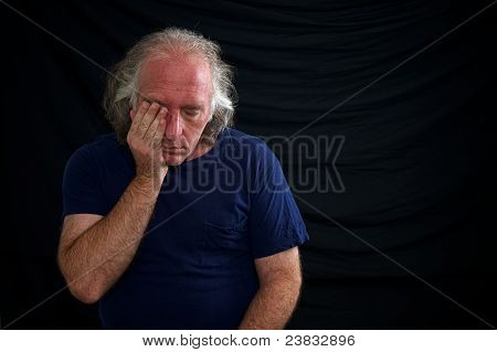 Upset Man Rubbing Eye