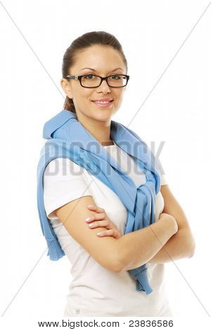 Smilimg girl with arms folded over white background isolated