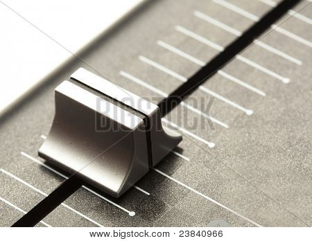 extreme closeup of a volume control fader