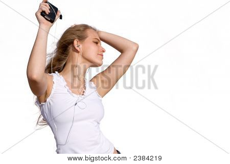 Young Woman Dancing To Mp3 Player