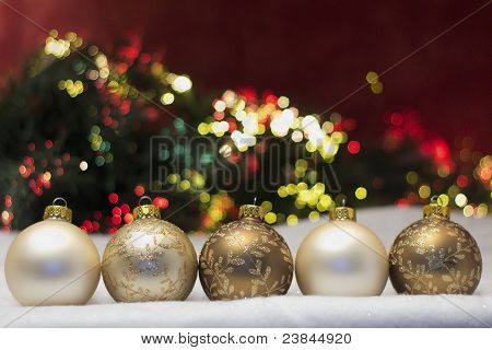 row of gold shaded baubles