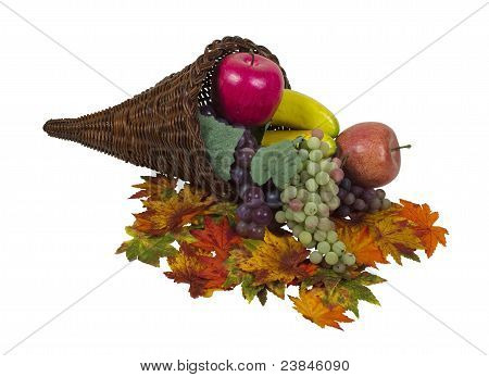 Fall Cornucopia With Colorful Fruit And Leaves