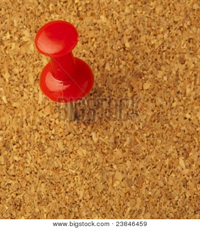 plastic thumbtack on cork billboard extreme closeup