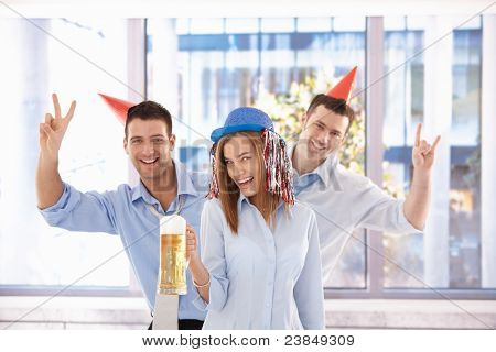 Young businessteam having party in bright office after work, laughing.?