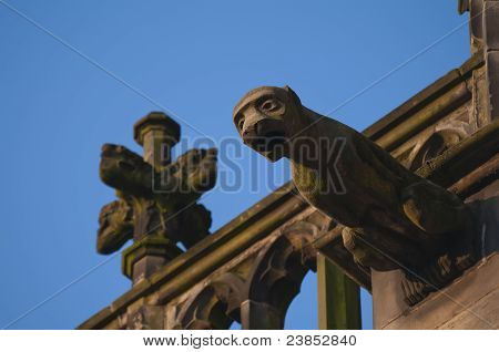 Sandstone Gargoyle On A Roof