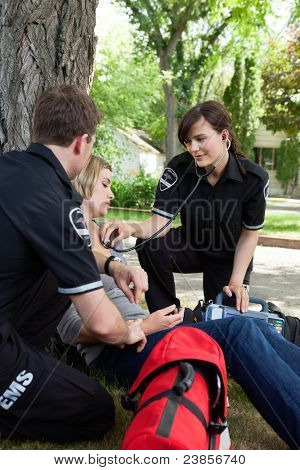 Emergency medical service attending to a injured patient