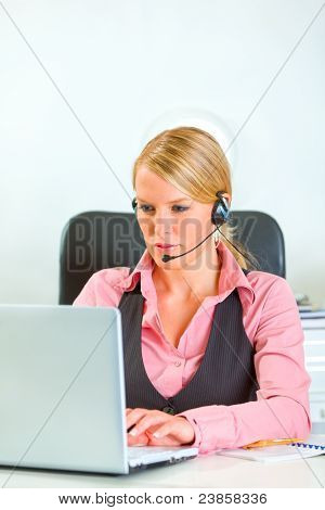 Modern Business Woman With Headset Working On Laptop
