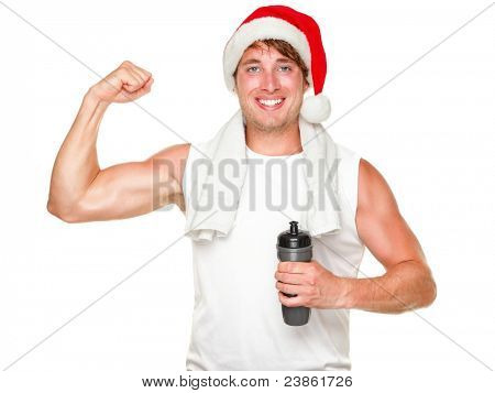 Christmas fitness man showing bicep muscles fit for holidays. Handsome male in his 20s wearing santa hat isolated on white background.