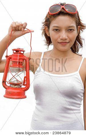 Girl holding a kerosene lantern
