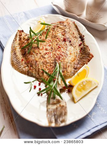 Closeup of pan fried  turbot with lemon and rosemary