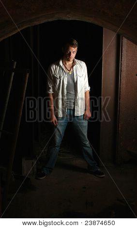 Intense Man Standing In Dark