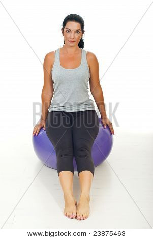 Woman Sitting On Pilates Ball