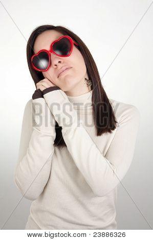 Dreamy Girl Wearing Heart-shaped Sunglasses