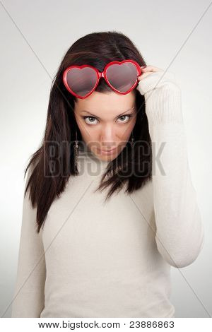 Girl Removing Heart Shaped Sunglasses