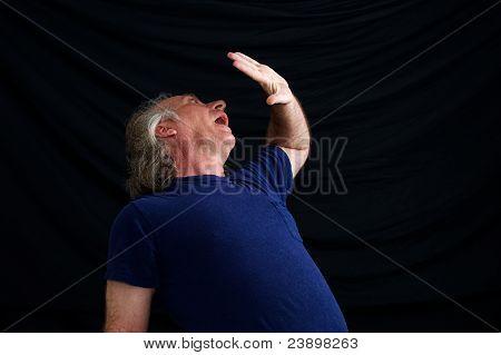 Man Cowering In Fear