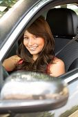 Young Hispanic Girl Excited About Her New Car. poster