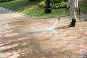Outdoor Floor Cleaning With A Pressure Water Jet On Street poster