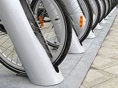 Public Bicycle Parking. City Bike Rental System. Bicycle Wheels Close Up poster